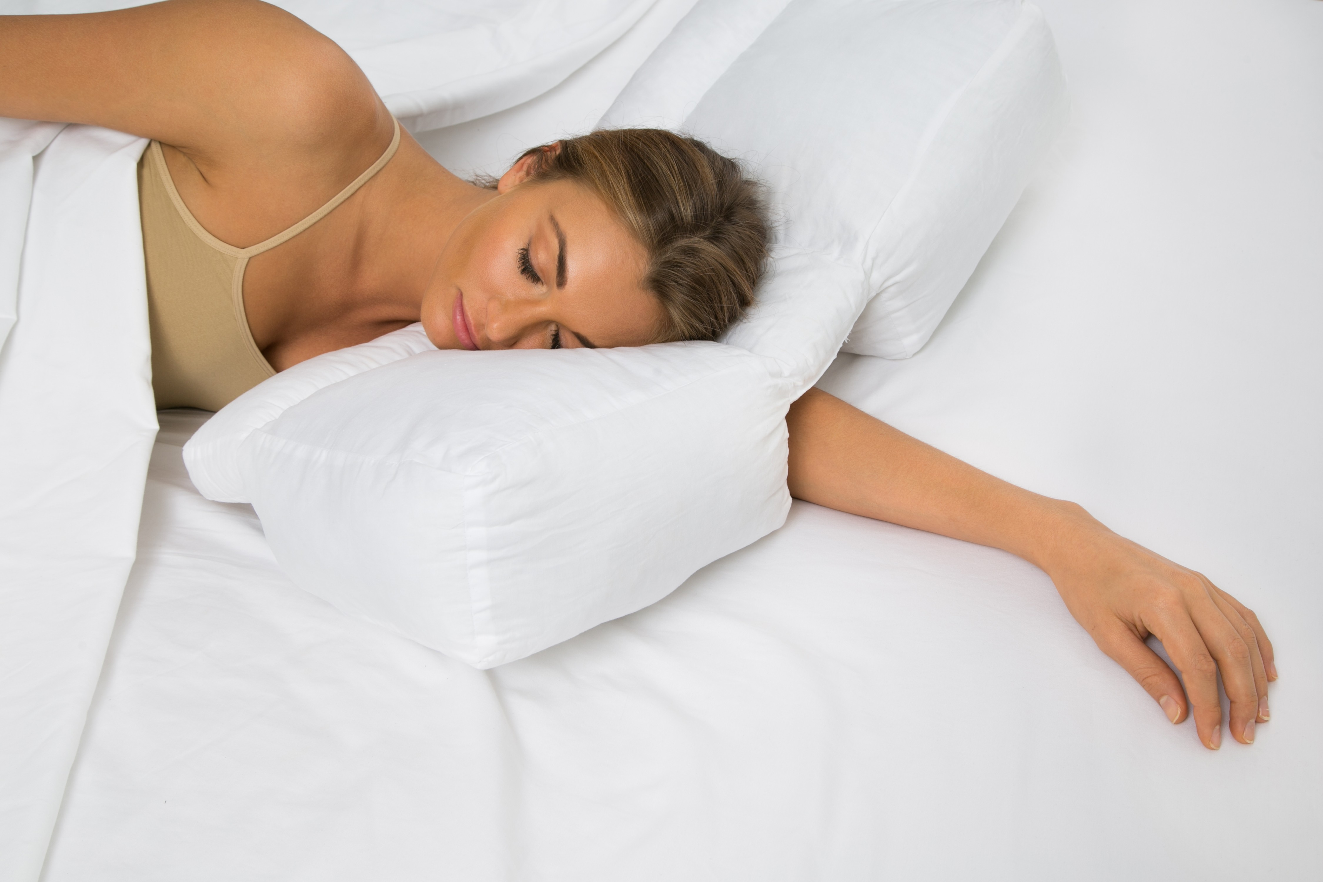 Better sleep pillow gel fiber pillow patented arm tunnel The more pillows you sleep with